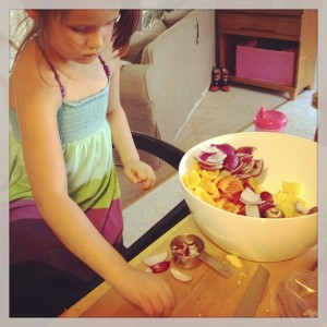 my favorite kitchen helper learned how to chop pineapple and skewer kabobs with me the other day
